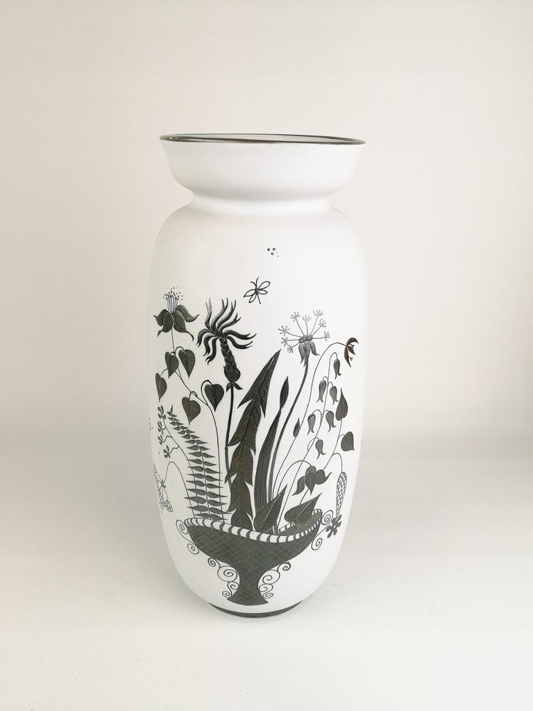 White large ceramic vase with silver overlay. Wonderful design from one of Sweden great Stig Lindberg. The vase is in good condition. Small loss of silver on the top.  Marked on the bottom, made in Sweden. Gustavsberg, Grazia 220 DM Sweden.