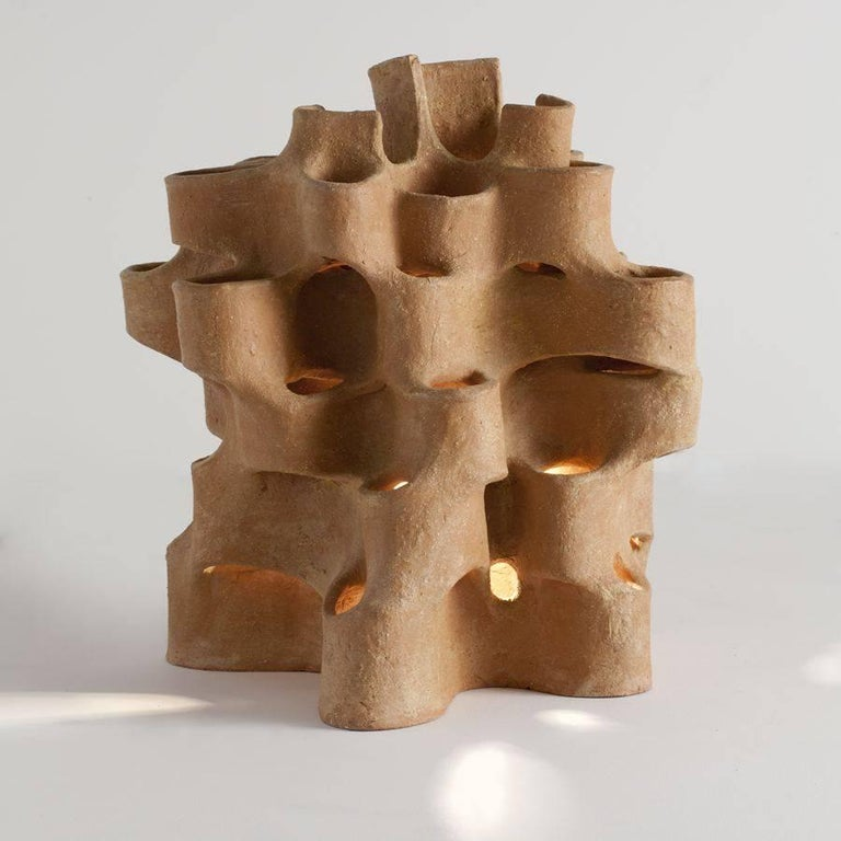 Unique piece Signed: Bareff  Bareff is inspired particularly by architecture, and interested in clay for its warmth of color and the tactility of its raw texture. The central dialogue of his work is the dynamic interplay of light and form in