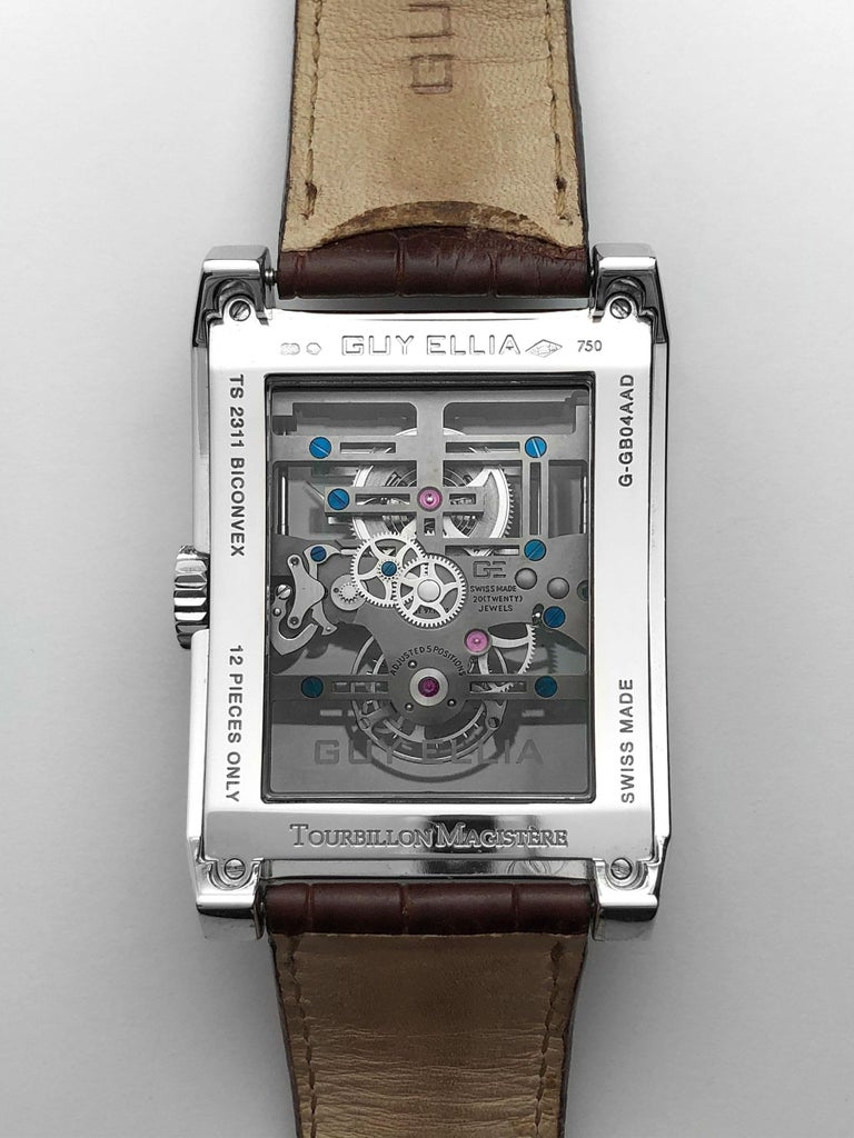 The Magistere is one of the few Guy  Ellia creations with an obvious signature. The G and the E act as the bridge for the barrel and the tourbillon's cage  respectively , completing minute long rotations. 18 Karat White Gold Reference # OG TS 2311