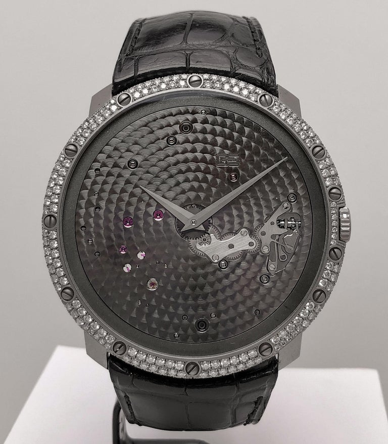 18Kt White Gold and Diamond Time Space Reference # OG-RS-2388 LV1 Manual Wind 46.8 mm diameter 56 diamonds 43 hour power reserve 30 meters water resistant Black  crocodile strap with 18kt white gold and diamond tang buckle Box and warranty