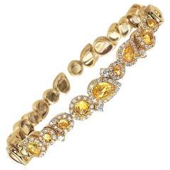 G.Verdi for Cellini, 18kt Gold, 2.88ct. Yellow Sapphire & .94ct. Diamond Bangle