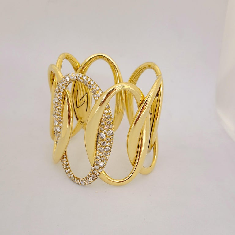 Made exclusively for Cellini NYC by g. Verdi of Italy, this 18 karat yellow gold and diamond cuff bracelet is a real showstopper. Interlocking links in a hi-polished yellow gold finish with the center link set entirely with rose cut and brilliant