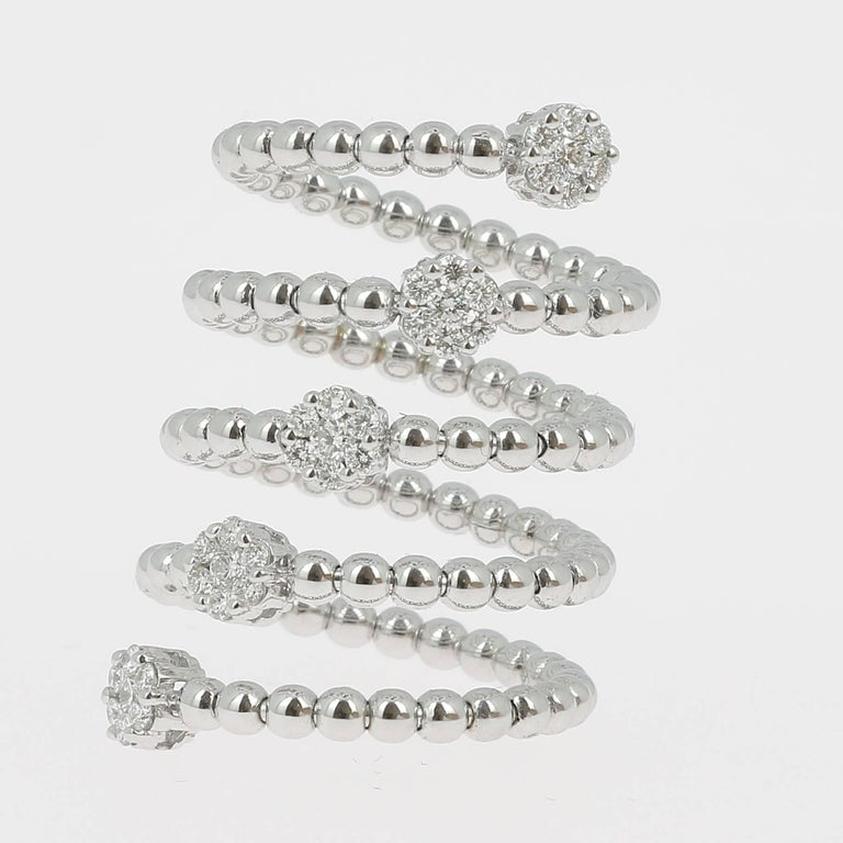 A fine and impressive GVS Certified 0.62 carat Diamond Ring There are 5 Round Diamonds weighing 0.20 Carat. There are 30 Rounds Diamonds weighing 0.42 Carat. The Ring is 18K White Gold. The Diamonds are GVS qualities. The Size of the ring is 6 ½ US.