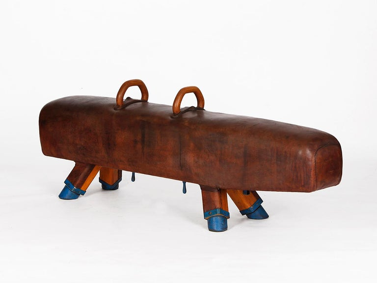 Early pommel horse with beautiful patina, shortened to bench height 51cm and very good vintage condition. Completely restored. The iron feet are preserved. The thick leather has been cleaned and preserved, restored wood surface and the patina was