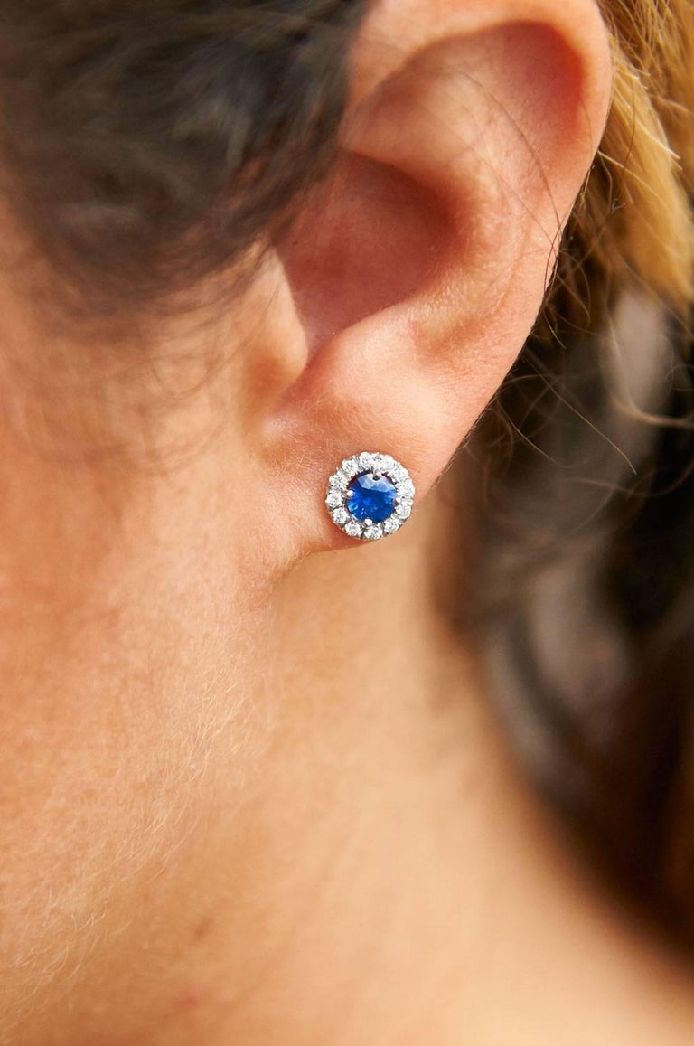 These impeccable 0.73 carat blue sapphires are embraced by 0.19 carat of pave-set diamond and fashioned from 18 karat white gold (G/H/VS/SI1).  These handmade stud earrings are an original H & H design and are the perfect combination of beauty and