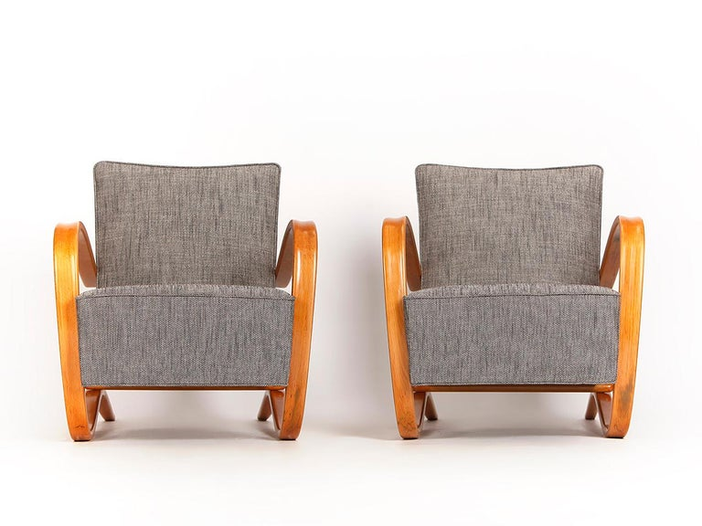 This pair of armchairs by Jindrich Halabala for Spojene UP Zavody was produced during the 1930s. They have been completely new upholstered with new springs and covered with a beautiful Romo fabric.