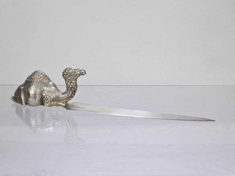 A wonderful figural sterling silver letter in the form of a one hump camel.    The camel wears a wry expression on its face and has a finely detailed, sculptural quality.     This is one of line of several very high quality camel items that H A Cary