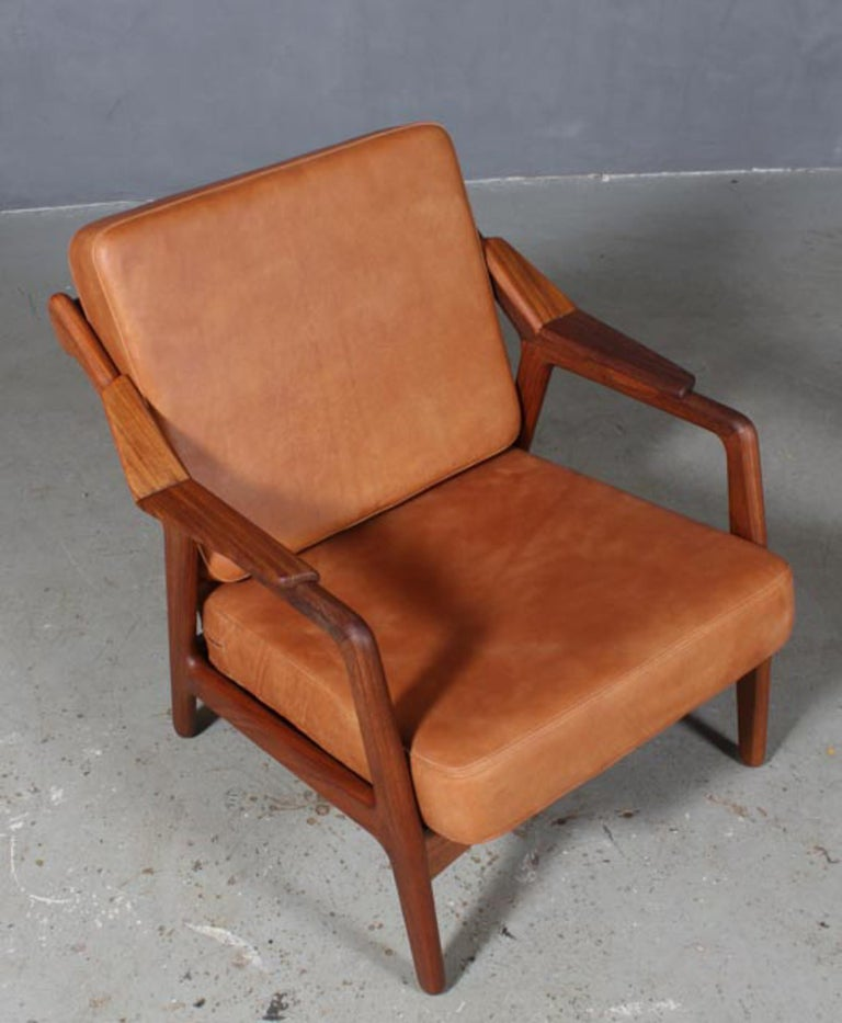 H. Brockmann Petersen lounge chair with frame of solid teak.  New upholstered with vintage tan aniline leather.