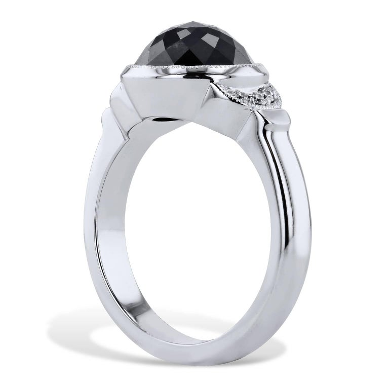 This 18 karat white gold handmade black and white diamond ring conjures the thought of the night sky punctuated by moonlight. A 4.00 carat rose cut black diamond is bezel-set at center and feature 0.06 carat of pave diamond in crescent moon shape