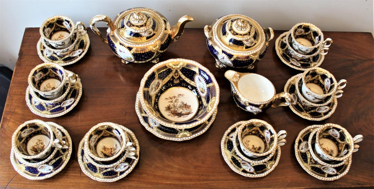 Made is approximately 1840 by H & R Daniel & Sons of England, this cobalt blue on a white ground tea or coffee set is meticulously decorated with hand painted vignettes on each piece. The artistic detail is exceptional and have several main scenes