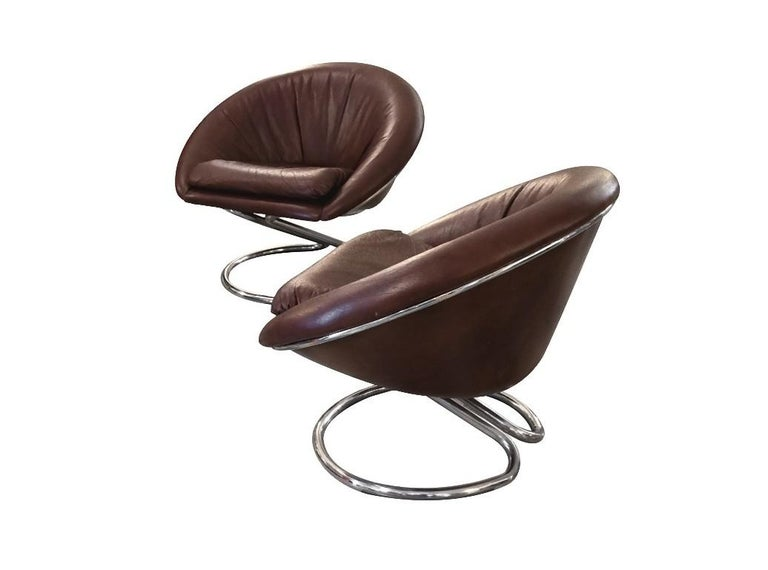 Pair of armchairs is an original design set realized in the 1970s by the Italian architect and designer Giotto Stoppino (Vigevano, 1926 - Milan, 2011).  Leather and steel.   Excellent conditions.   The pair of armchairs are entirely made in