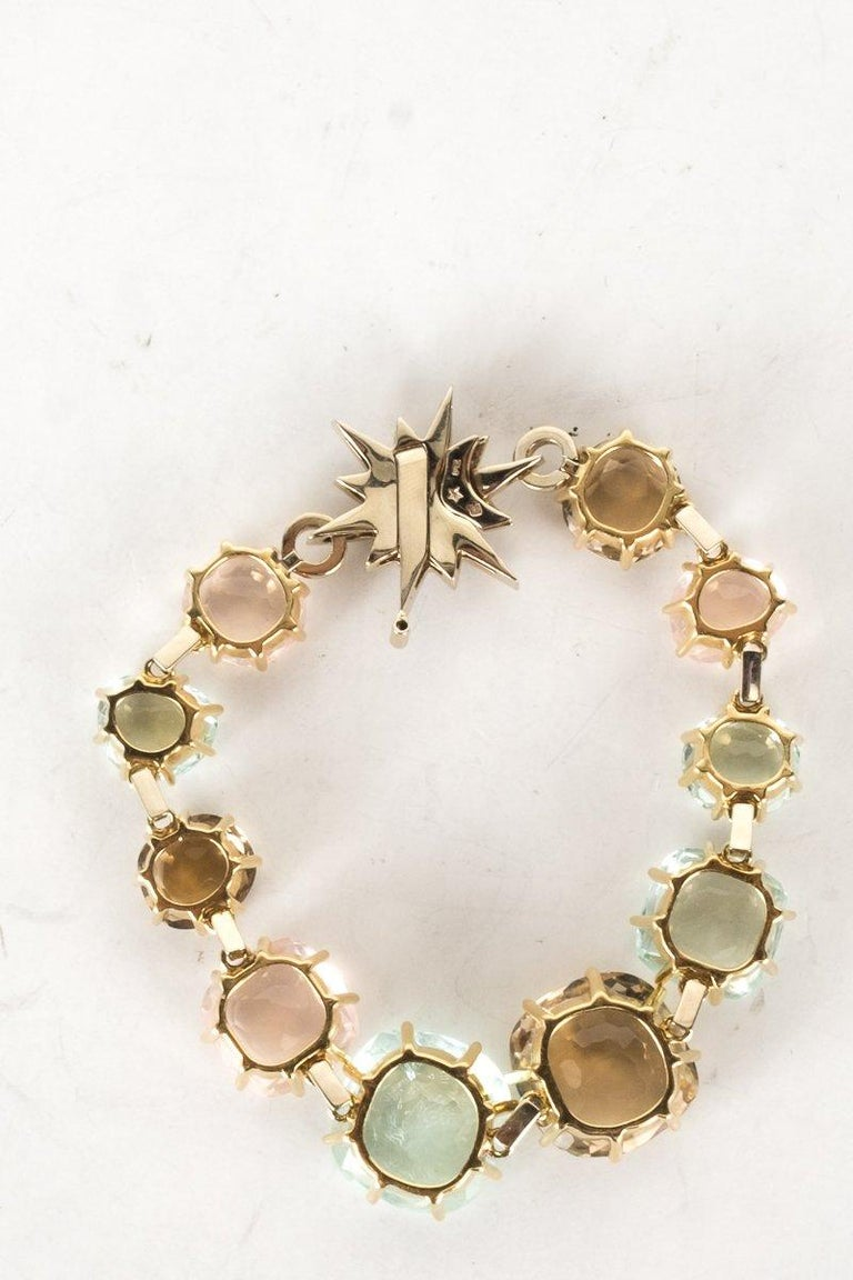 H. stern 18k yellow gold metallic Moonlight bracelet with multicolored faceted gemstone fixed bracelet, Noble star closure featuring pavé set round brilliant cut diamond, and push-lock closure with safety bar. From the Moonlight collection.   Metal