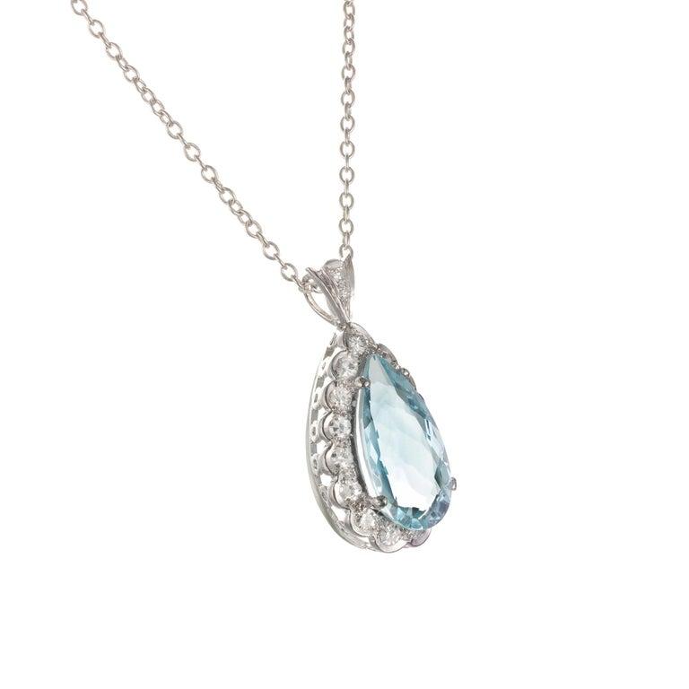 Vintage H Stern fine pear-shaped Aqua and single cut diamond halo pendant. 18k white gold setting and chain. Circa 1950-1960.  1 pear light blue Aquamarine, approx. total weight 4.40cts  17 single cut Diamonds, approx. total weight .42cts, H, VS