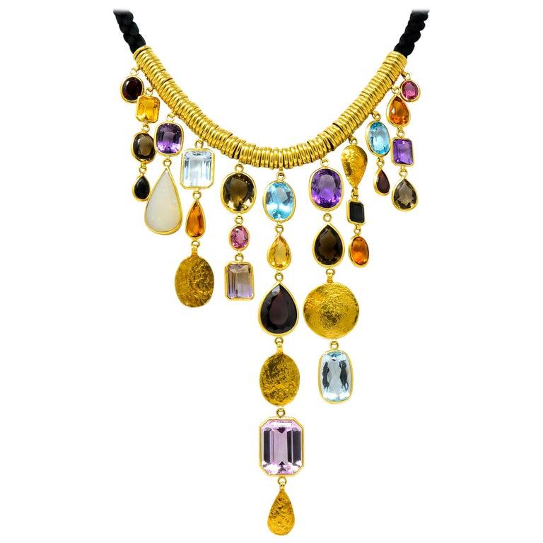 H. Stern Vintage 1970s Multi-Gem Aquamarine 18 Karat Gold Cord Drop Necklace For Sale