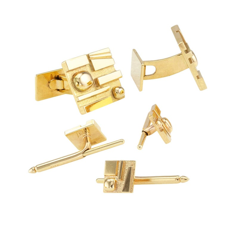 H Stern Yellow Gold Gentlemans Dress Set.  DETAILS: H Stern yellow gold gentleman's dress set comprising a pair of cufflinks and three shirt studs circa 1970 design attributed to Burle Marx. METAL: 18-karat yellow gold. MEASUREMENTS: cufflink faces