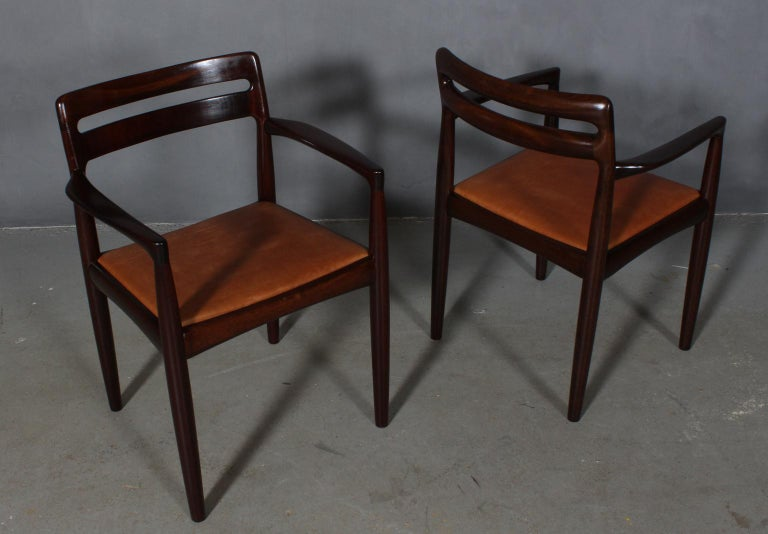 H. W. Klein set of armchairs in mahogany.  New upholstered with vintage tan aniline leather.  Made by Bramin.