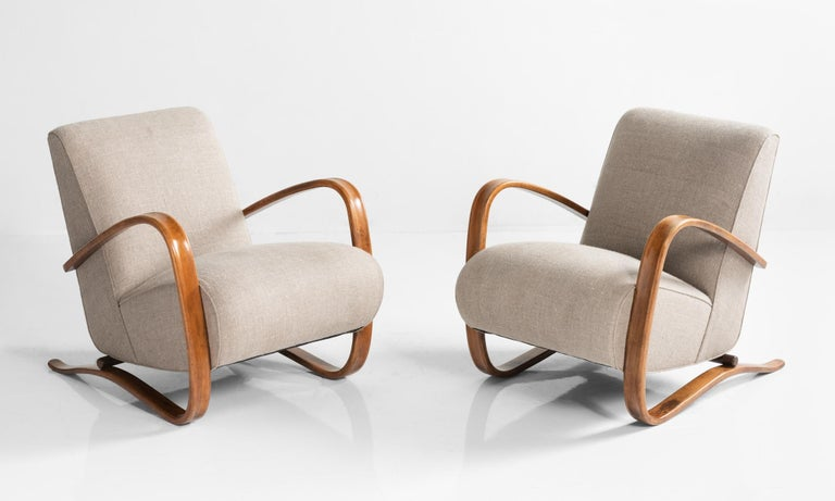H269 Armchairs by Jindrich Halabala, Czech Republic, circa 1940  Iconic form, newly upholstered in a natural cotton slub fabric with original bentwood arms and legs.