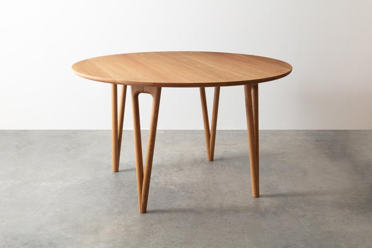 The hair pin table uses a solid wood interpretation of a Classic leg giving new style to this seemingly traditional support.  Shown in white oak 52