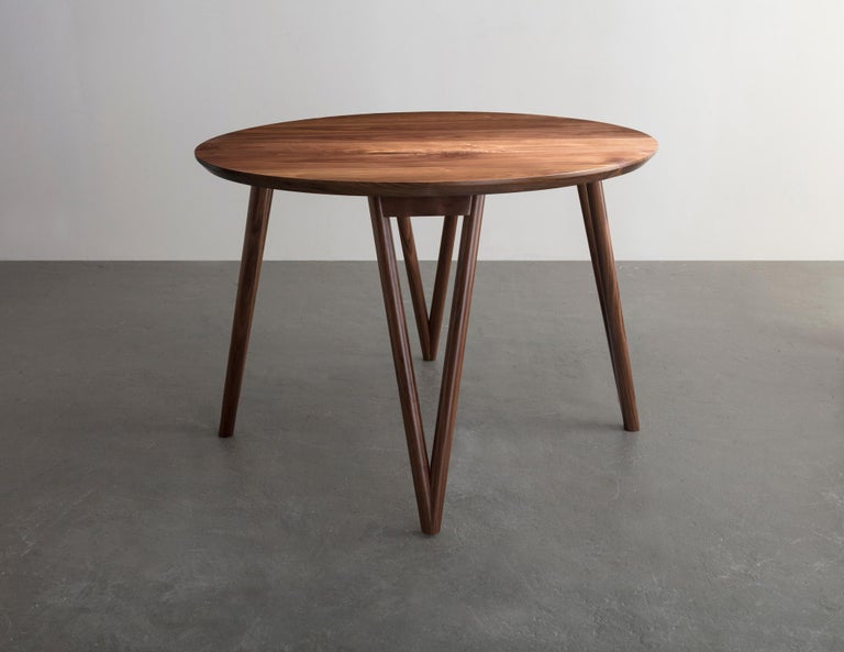 The Hair Pin table uses a solid wood interpretation of a classic leg giving new style to this seemingly traditional support.  Shown in walnut and available in ash, maple, or white oak.