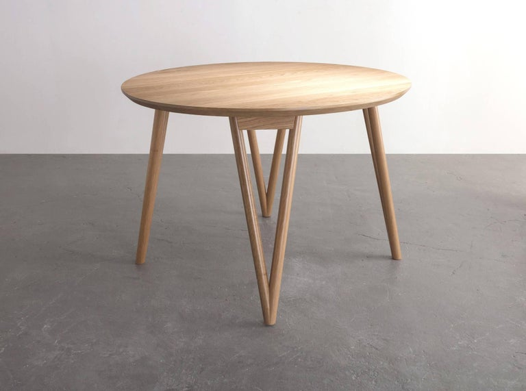 The Hair Pin table uses a solid wood interpretation of a classic leg giving new style to this seemingly traditional support.  Shown in white oak and available in ash, maple, or walnut.