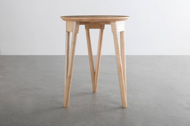 The Hair Pin Table uses a solid wood interpretation of a classic leg giving new style to this seemingly traditional support.  Shown in maple and available in ash, white oak, or walnut.