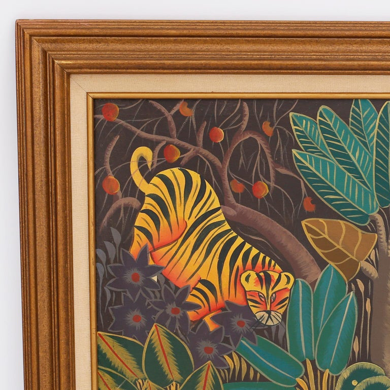Whimsical oil painting on canvas with tigers and elephants in a stylized jungle setting, painted in a folky, naive style typical of Haitian artists. Signed Yvon at the bottom and presented in a wood frame.