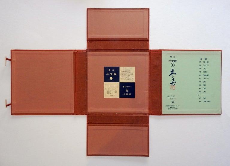 Paper Haku Maki Set of Twelve Miniature Color Woodblock Prints in Cloth Case For Sale