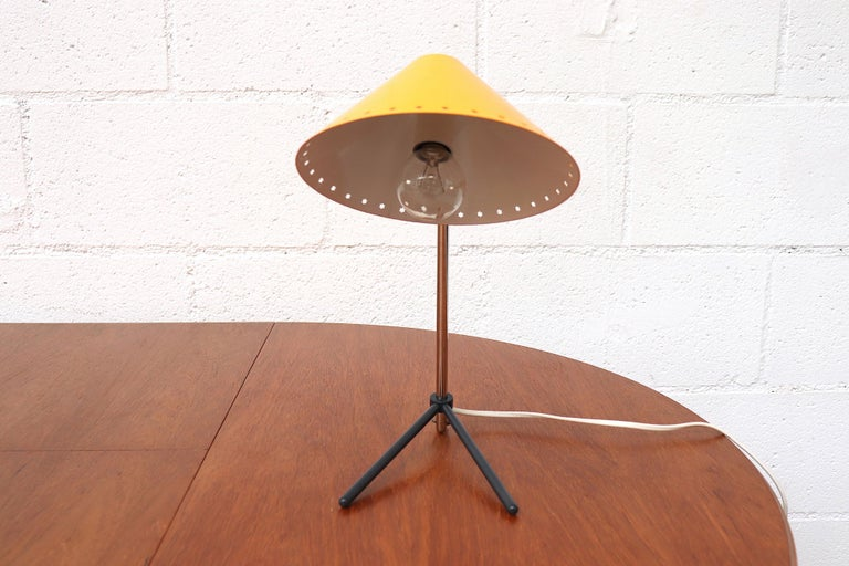Hala Zeist yellow enameled metal table or wall lamp with Pinocchio shade. Versatile small lamps that function as both table lamp and wall lamp. Great as bedside lamps. New old stock. Also available with red shade, listed separately (LU922418352322).