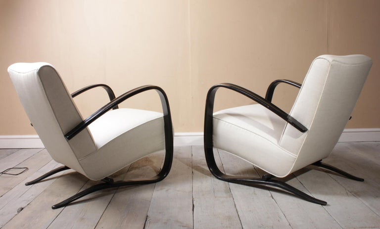 Halabala armchairs H269 A pair of model H269 armchairs designed in 1935 by jindrich Halabala and produced in chzecoslovakia by up to the end of the 1950s this pair are early 1940s with original ebonized arms and have been fully re