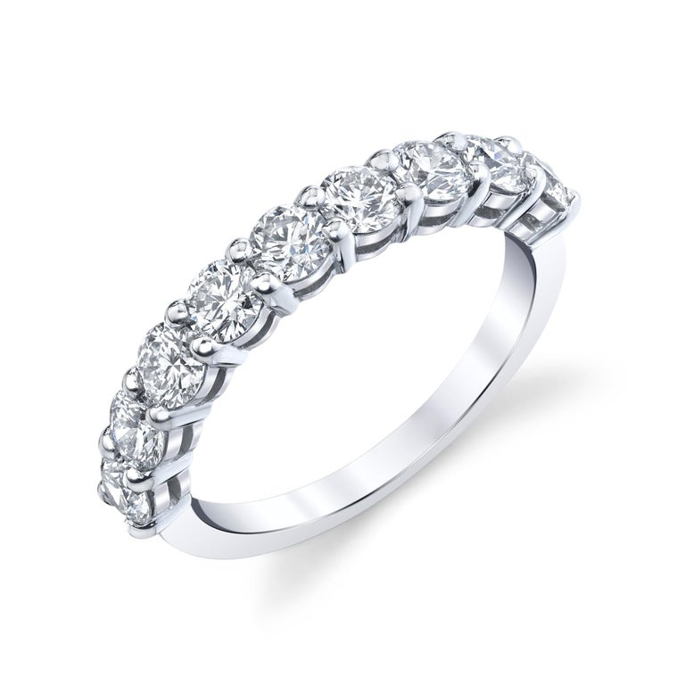 9 Round Brilliant Cut Diamonds set in a platinum eternity band with a total weight of  1.30 carat.  Approximate Color H - I Clarity VS - SI   Ring size 6.5  * Can be resized by your trusted jeweler or we can resize it for you.