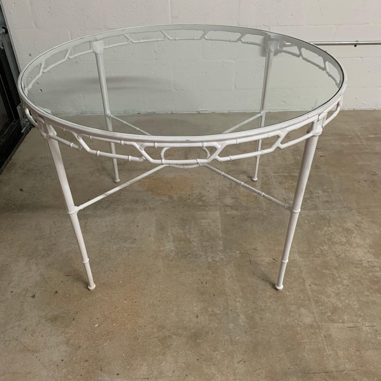 Classic Chinese Chippendale faux bamboo dining table for outdoor, garden, or patio rendered in original white powder-coated cast aluminum with a glass top. Designed by Hall Bradley for Brown Jordan, 1967.