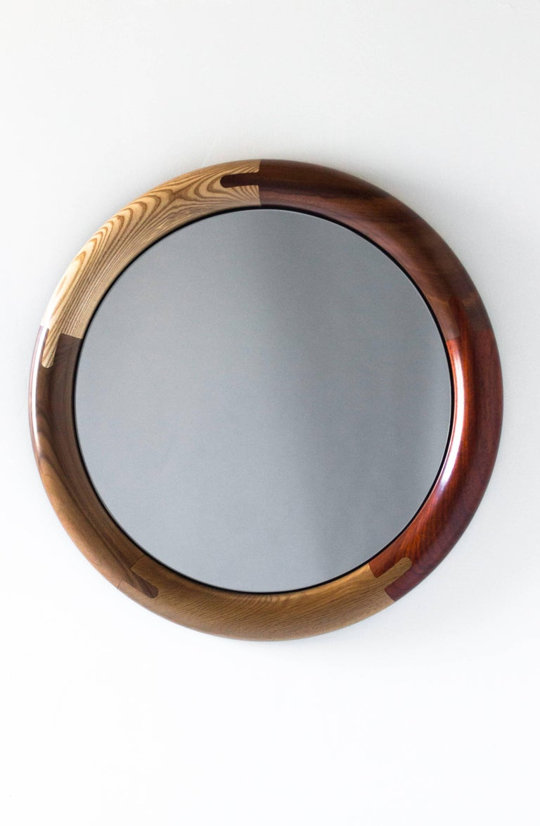 Composed of a richly colored range of wood species and featuring detailed joinery and simple, legible construction, the Halo Round Mirror makes you look good just for owning it.
