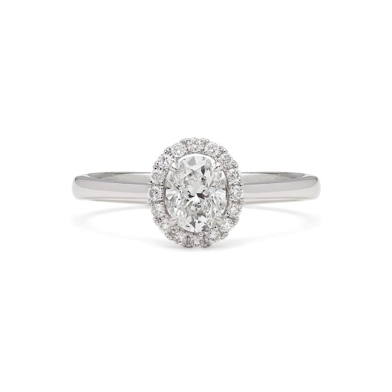 Halo Oval Diamond White Gold Engagement Ring In Excellent Condition For Sale In San Francisco, CA