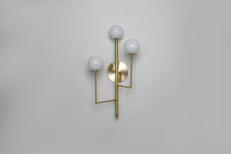 Kalin Asenov designs and fabricates lighting in Savannah, GA. Asenov works with a team of artisans and manufacturers to prototype, and build all pieces in his studio.  The design of Halo interprets ideas of celestial secret geometry; the form