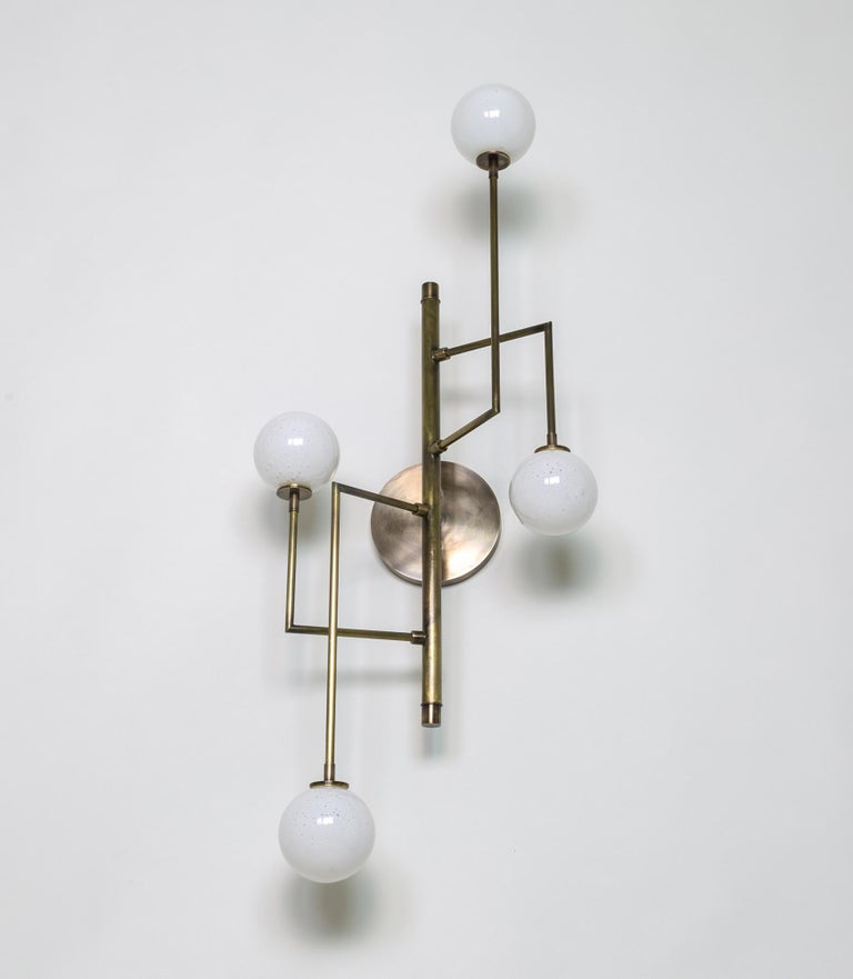 Kalin Asenov designs and fabricates lighting in Savannah, GA. Asenov works with a team of artisans and manufacturers to prototype, and build all pieces in his studio.
