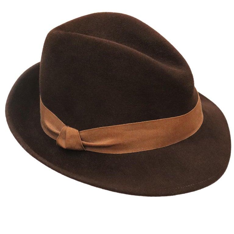 Halston Brown Felt Hat W/ Ribbon Trim Circa 1980s. In excellent condition