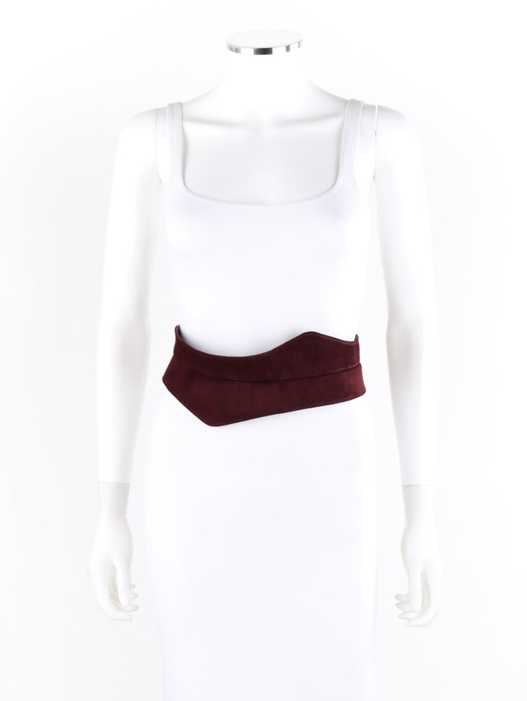 HALSTON c.1970's Burgundy Suede Leather Art Deco Avant Garde Tied Obi Waist Belt   Circa: 1970's Brand/Manufacturer: Halston Designer: Roy Halston Frowick Style: Obi belt Color(s): Shades of red Lined: Yes Unmarked Fabric Content: Suede (exterior);