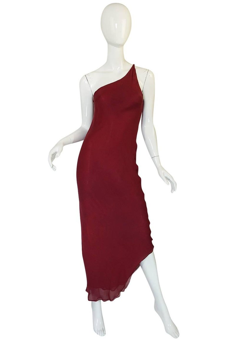 This is an amazing couture Halston set that is absolutely divine and very rare and special! It is entirely cut on the bias with minimal seaming as was his signature style. The color is two tones of hand dyed color - a deep burgundy and a lighter hue