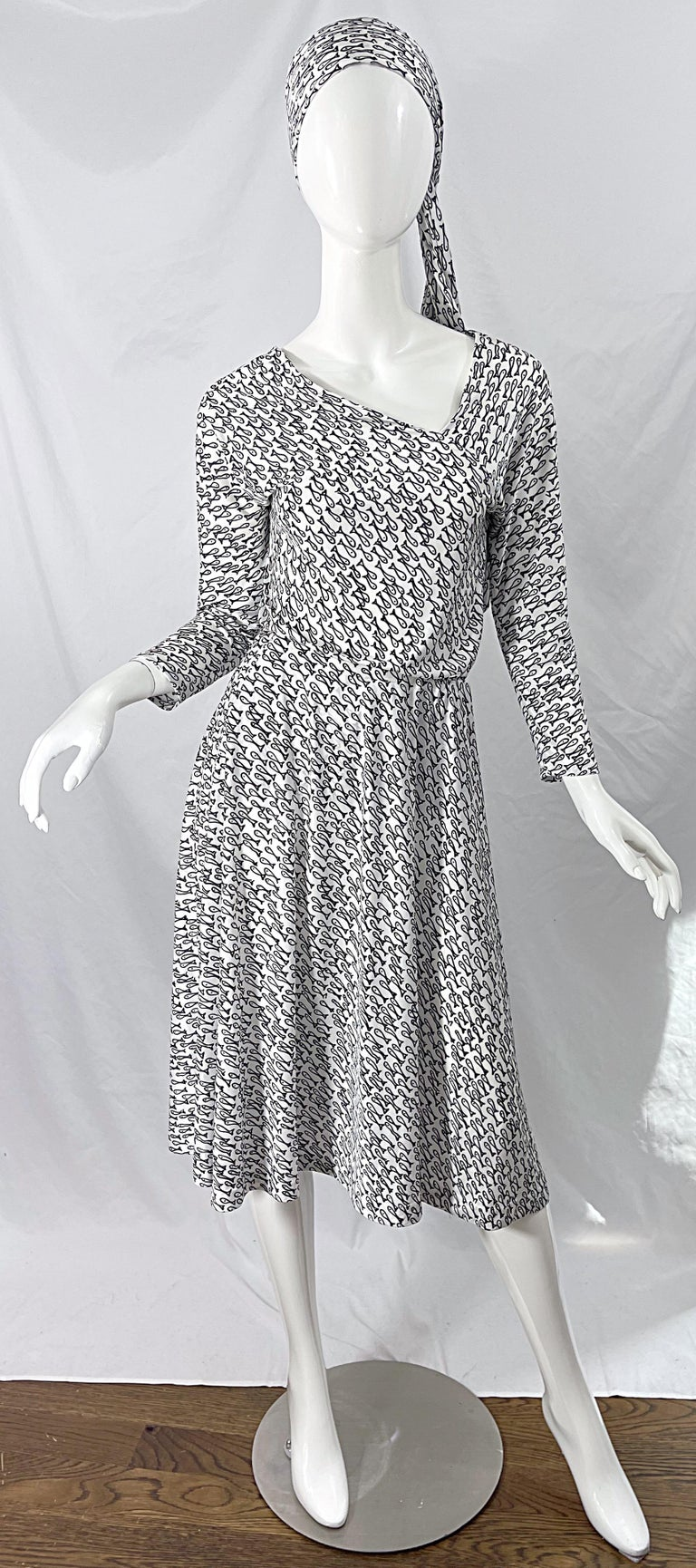Rare HALSTON IV 1970s black and white novelty fish print three piece jersey ensemble ! Top features an asymmetrical neckline on the front and back. Skirt is a flirty easy fit with an elastic waistband. Sash can be used as a belt or head scarf. All 3