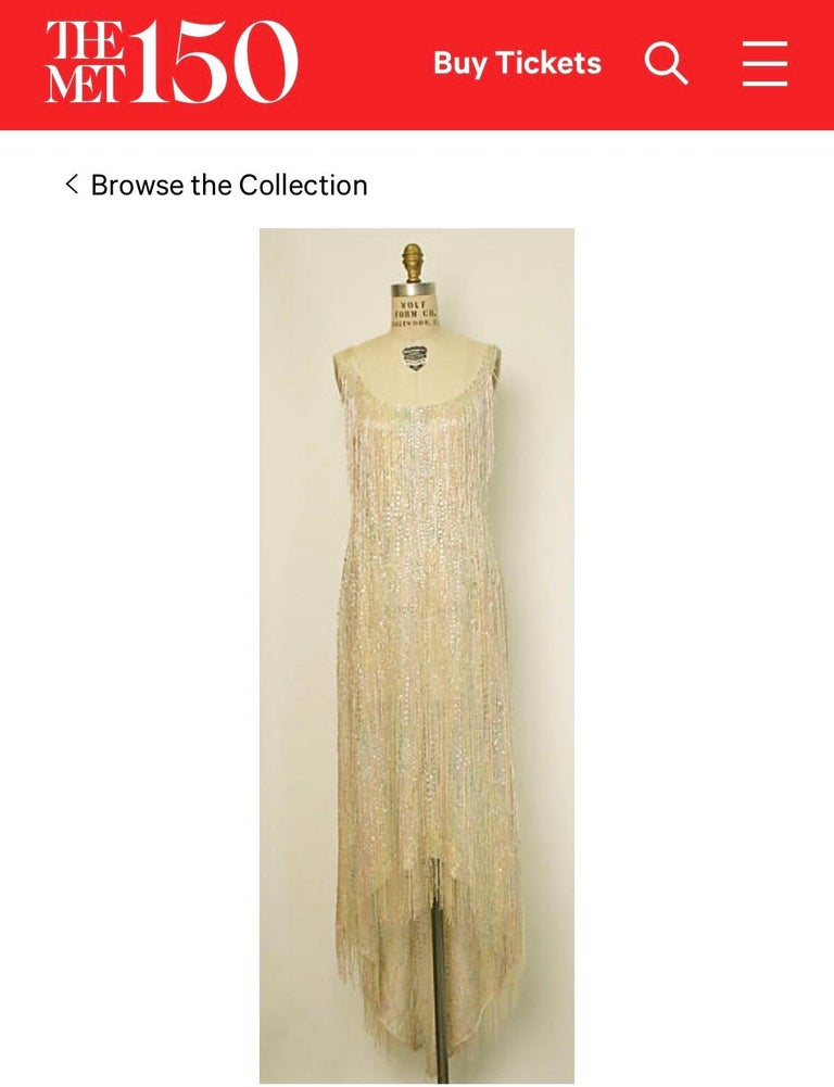 Extraordinary and super rare HALSTON Couture 1970s fully beaded and sequin fringed silk chiffon hi-lo flapper dress! An almost exact version of this rare gem is in the MET Museum! Features a rainbow of pastel ombre colors. Dipped hi-lo hem is longer