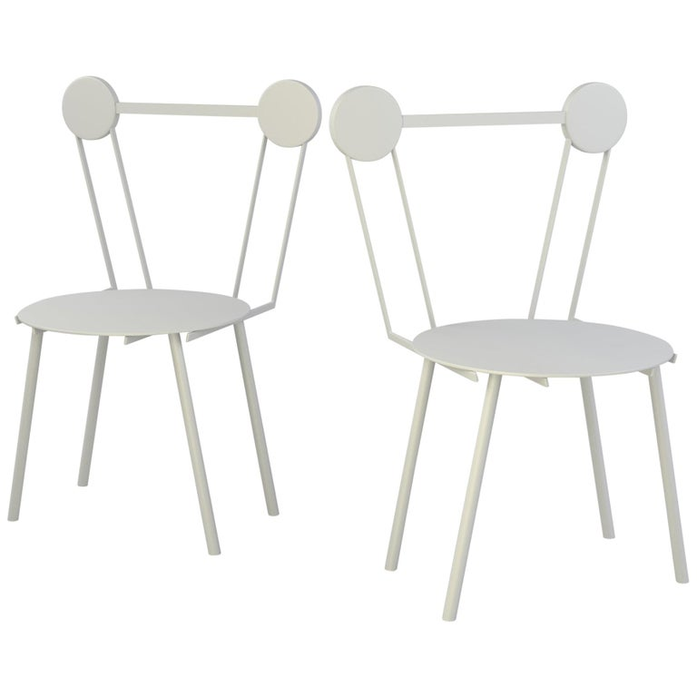 Carved in metal Haly chair presents a bold attitude and a delicate profile.   Haly was designed by combining the different methods of metal working with research on the treatment and finishing of aluminum surfaces. In contrast to the strength of the