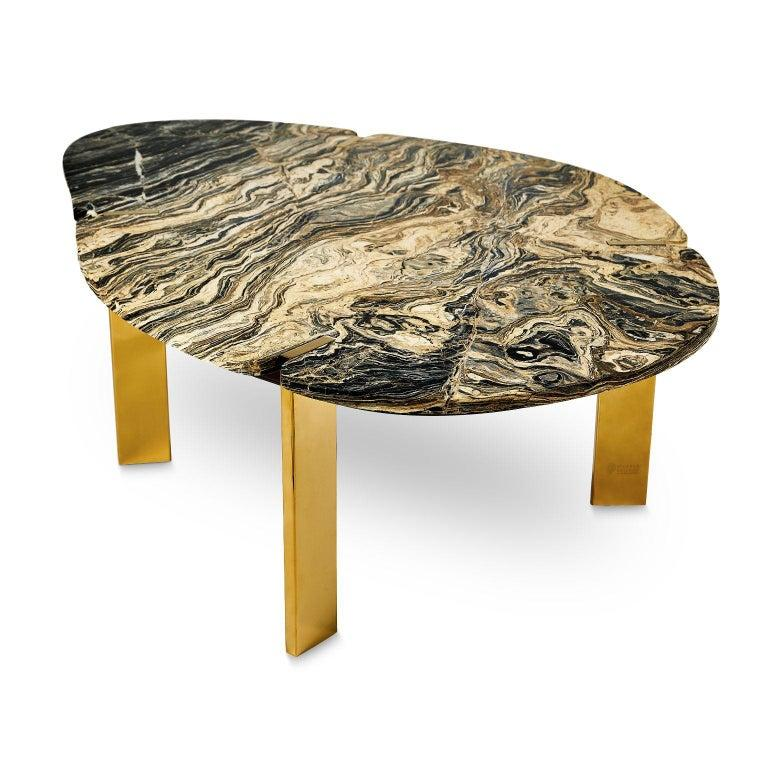 Halys coffee table gold by Marble Balloon Dimensions: H 39.5cm x 88cm x 130 cm Materials: Titanium coating, stainless metal and marble.  It consists of carrier legs made of titanium coating on stainless metal and a marble top.  Marble Balloon