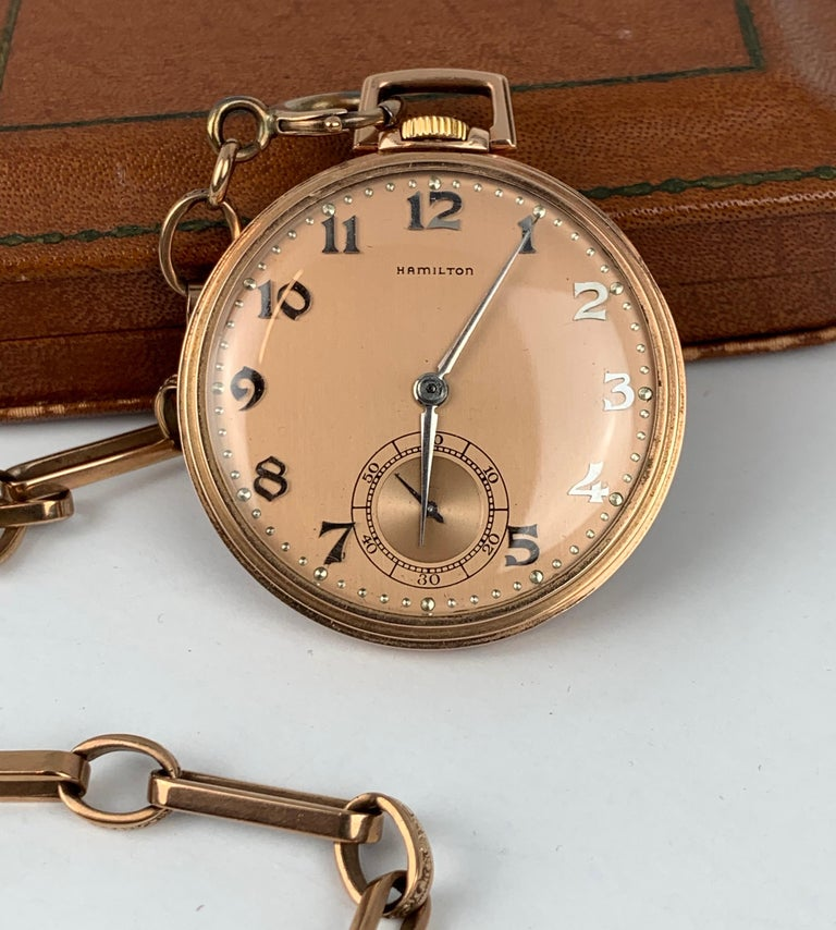 Hamilton 14k rose gold pocket watch and chain.  When you research the movement serial number of #1205496 October 21, 1916 comes up as its date of manufacture.  The open face 1/4