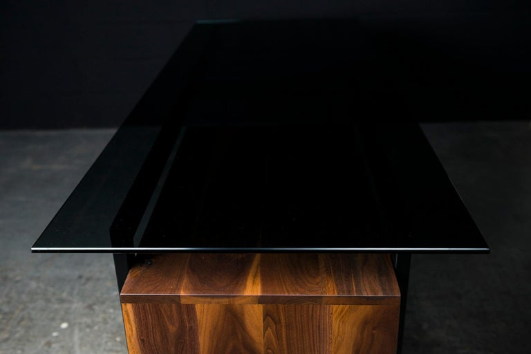 """The Hamilton modern working desk is handcrafted from a light weight 2"""" x 1"""" steel frame. Featuring a nice 10mm tinted tempered glass which let you see the solid wood storage box underneath the working surface. Our Hamilton modern desk is also"""