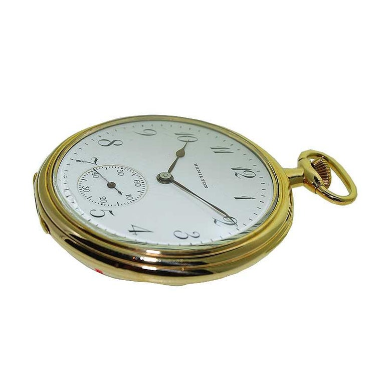 FACTORY / HOUSE: Hamilton Watch Company STYLE / REFERENCE: Open Faced Pocket Watch  METAL / MATERIAL: Yellow Gold Filled CIRCA / YEAR: 1921 DIMENSIONS / SIZE: 47 mm  MOVEMENT /10 CALIBER: Manual Winding / 17 Jewels  DIAL / HANDS: Kiln Fired Enamel