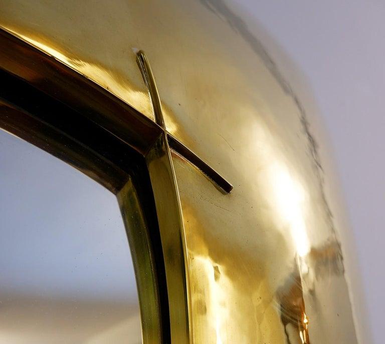 Hammered brass mirror.