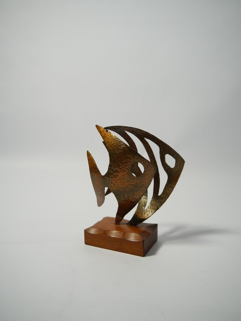 Stylized fish sculpture made from hammered copper. Marked at base