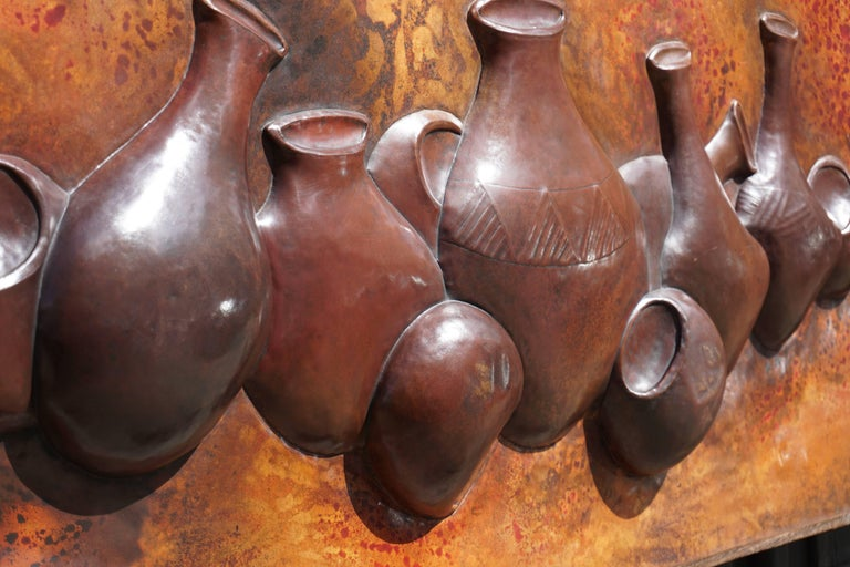 Hugh, lighted wall relief or object with African pots. This unique object is made by an Congolese artist and is in very good condition. Measures: Width 121 cm. Height 51 cm.