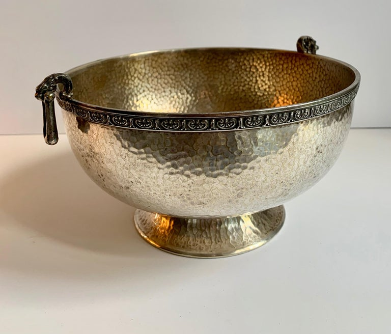 Hammered silver bowl with handle and rim detailing, a wonderful decorative bowl with great practical appeal. The rim is a fabulous detailed scroll reminiscent of a Greek key, with dangling rectangular detailing, similar to wonderful earrings.
