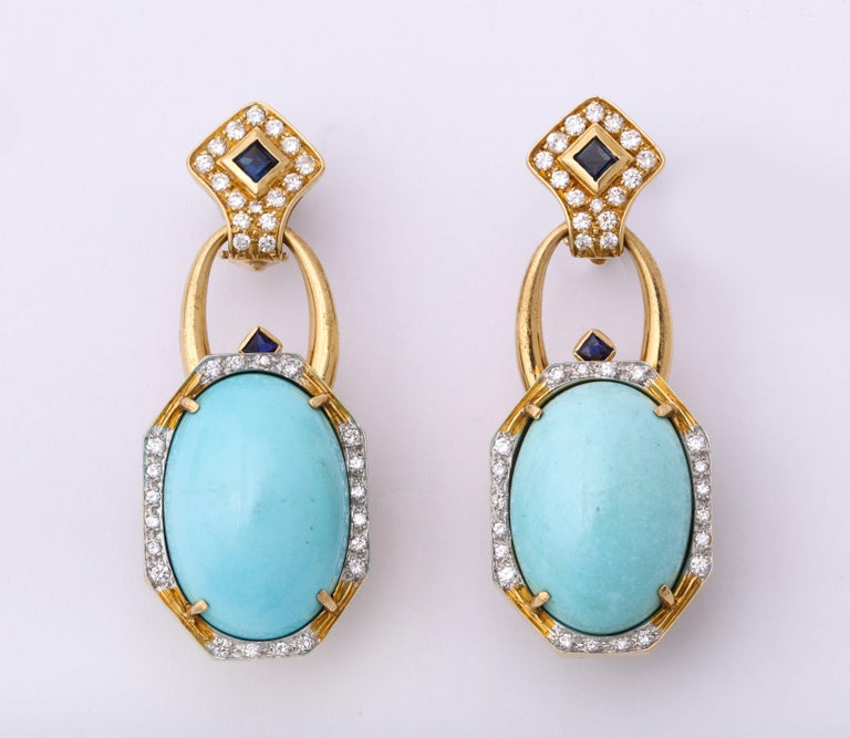 One Ladies Sleeping Beauty Turquoise Ensemble Crafted In 18kt High Polish Gold Set With Numerous Full Cut Diamonds And Custom Cut Sapphires For Earclips. Note:Earclips Can Be Detached And Worn I Two Ways. Large Two Inch Turquoise Brooch With